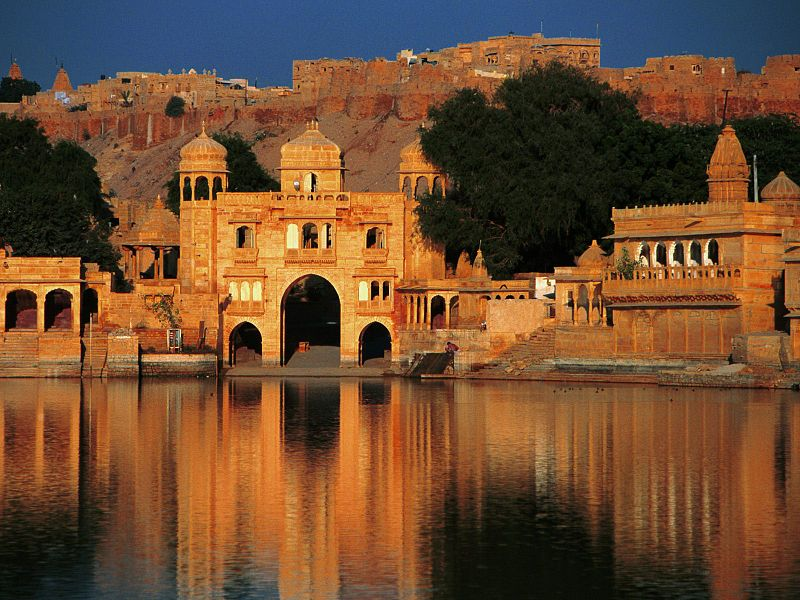 Shiva Temple and Tilon Gate on the banks of Gadi Sagar, Jaisalmer, Rajasthan, India